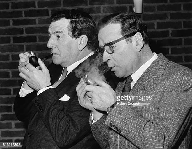 The Belgian born French novelist Georges Simenon meets and smokes with the English actor Rupert Davies, at the BBC TV Studios, London, 1962. Davies...