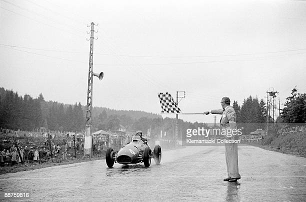 The Belgian Grand Prix SpaFrancorchamps June 22 1952 Alberto Ascari takes the finishing flag to win this race in difficult weather conditions
