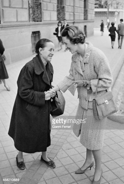 The Belgian Queen Fabiola is greeted by an old lady Madrid Spain
