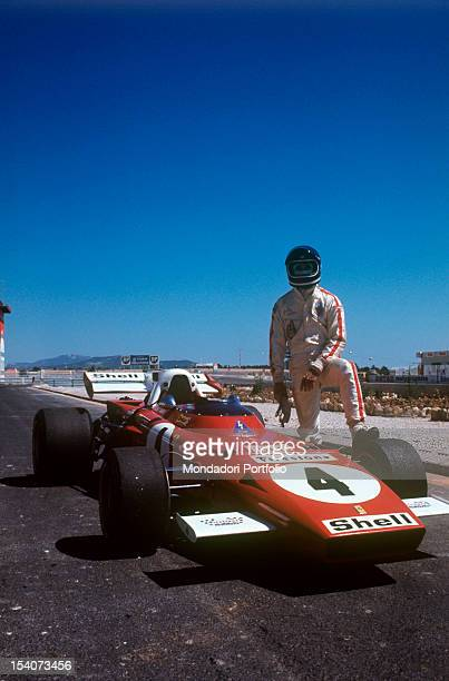 The Belgian racing car driver Jacky Ickx leaning his leg on the tyre of a Ferrari 312 B2 during a break in the French Grand Prix Le Castellet July...