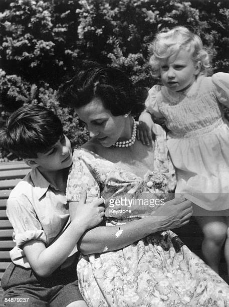 The Belgian royal family enjoy a day out at Laeken a suburb of Brussels 1953 Princess Lilian shares a bench with her son Alexander and her daughter...