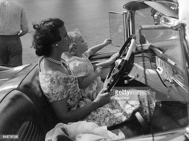 The Belgian royal family enjoy a day out at Laeken a suburb of Brussels 1953 Princess Lilian and her daughter MarieChristine sit in the front seat of...