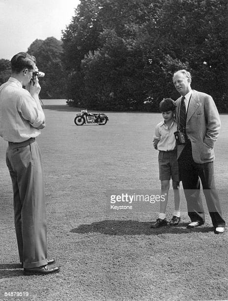 The Belgian royal family enjoy a day out at Laeken a suburb of Brussels 1953 King Baudouin 1 takes a photograph of his father the former King Leopold...
