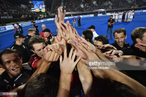 The Belgium side high five after victory over England during the FIH Men's Hockey World Cup SemiFinal match between England and Belgium at Kalinga...