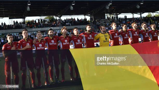 The Belgium team stand for their national anthem during the Men's FIH Field Hockey Pro League semi-final match between Belgium and Netherlands at...