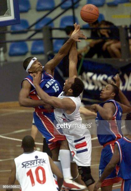 The Beliz basketball player Luis Castillo and Costa Rican player Ulises Rodriguez fight for the ball at the VII Juegos Deportivos Centroamericanos in...