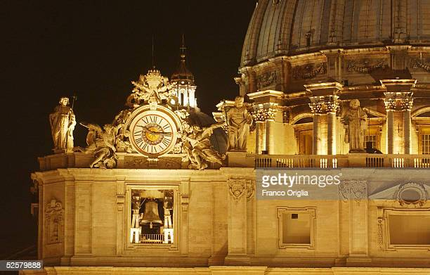 The bell and clock of St Peter's Square is seen during the announcement of the Pontiff's death on April 2 2005 in Vatican City The Vatican has...