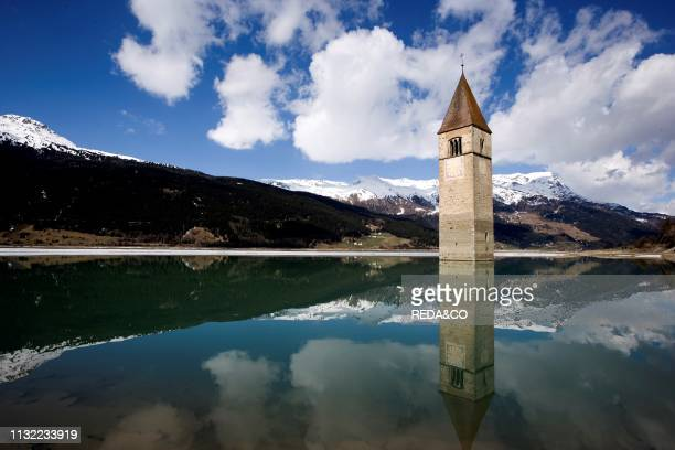 The bell tower in Reschensee. Lago di Resia. Lake Reschen. South Tyrol. Italy. Europe.
