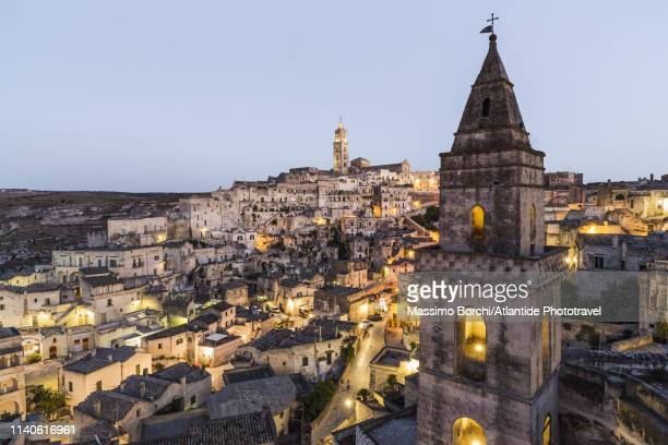 the bell tower of chiesa di san pietro barisano (originally known as st. peter de veteribus) and the sasso barisano - basilicata region stock pictures, royalty-free photos & images