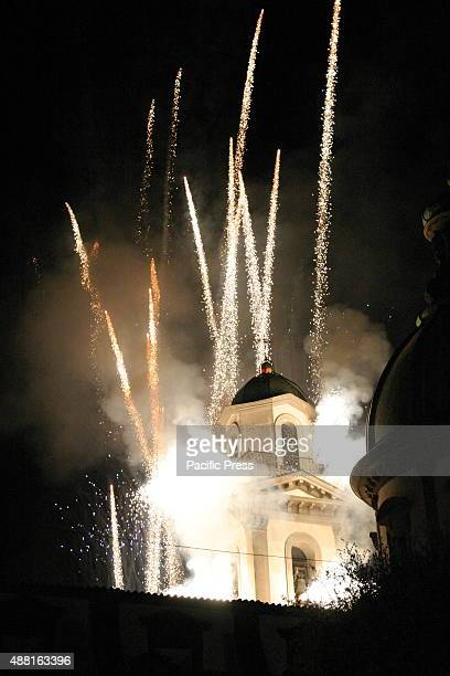 The Bell Tower of the Marian Shrine surrounded by fireworks with many colors The simulated Incendio del Campanile of the Marian Shrine is a high time...