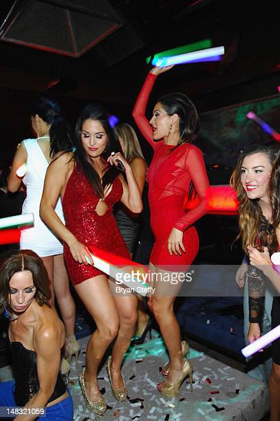 The Bella Twins Nikki Bella and Brie Bella attend the Tabu Ultra Lounge at the MGM Grand Hotel/Casino on July 13 2012 in Las Vegas Nevada