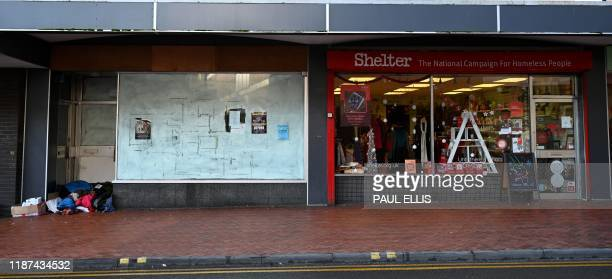 The belongings of homeless are seen in the doorway of an unoccupied shop unit next door to the Shelter charity store in the town centre in Wrexham on...