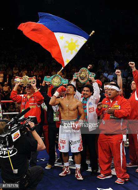 The belts of Manny Pacquiao of the Philippines are held up before his match against David Diaz during the WBC Lightweight Championship at the...