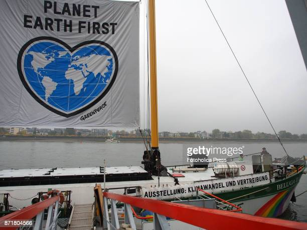 The Beluga II a ship of the Greenpeace fleet anchored on the bank of the Rhine as part of the United Nations Framework Convention on Climate Change...