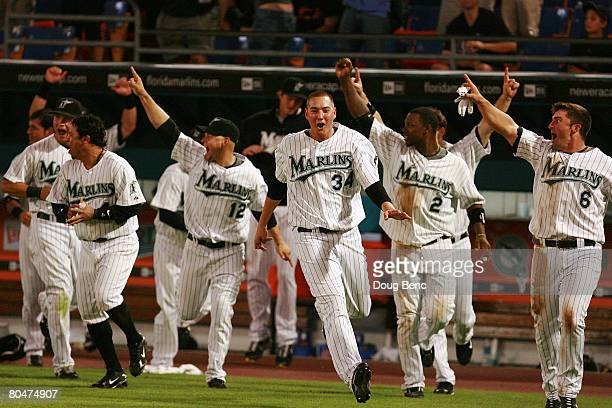 The bench of the Florida Marlins comes flying out of the dugout as Robert Andino hits a walkoff solo home run against the New York Mets at Dolphin...