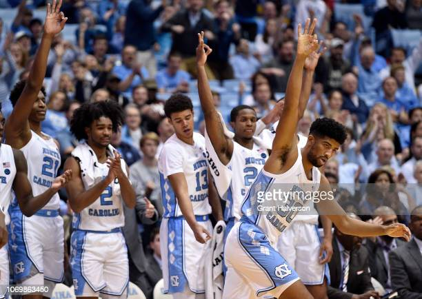 The bench reacts after a threepoint basket by KJ Smith of the North Carolina Tar Heels during the second half of their game against the St Francis...