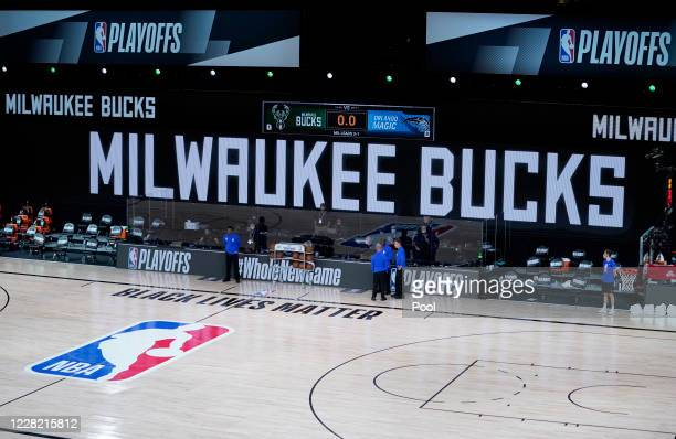 The benches are empty at the scheduled start of the first half of game five between the Orlando Magic and the Milwaukee Bucks in the first round of...