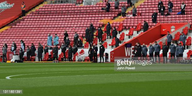 The benches pay their respects for Prince Philip before the Premier League match between Liverpool and Aston Villa at Anfield on April 10, 2021 in...