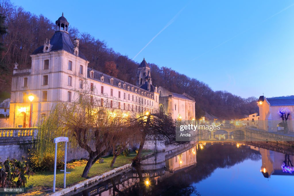 The Benedictine Abbey of Brantome, on the banks of the Dordogne river, at sunrise. The Abbey Church is classified as a National Historic Landmark (French 'Monument Historique').