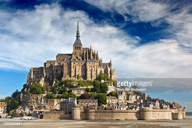 the benedictine abbey of mont saint michel against a clouded sky - モンサンミッシェル ストックフォトと画像