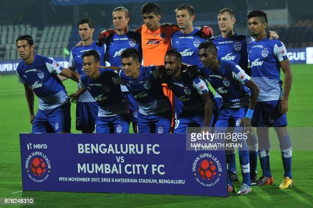 The Bengaluru FC team poses for a group photo ahead of the Indian Super League football match between Bengaluru FC and Mumbai City FC at Sree...
