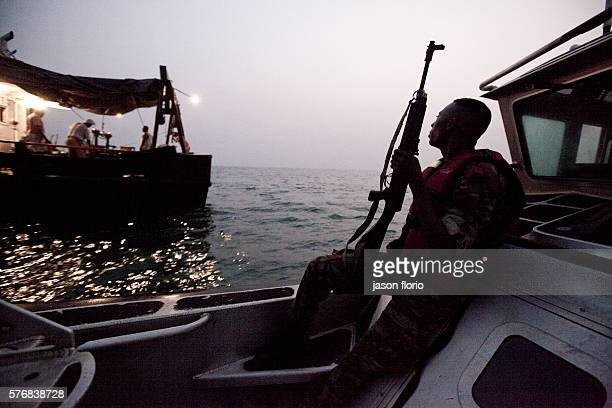 The Benin navy's antipiracy team on evening patrol in the Bight of Benin checking on a vesselPiracy off the small west African country of Benin has...