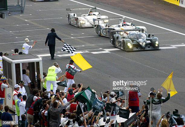 the Bentley N7 driven by British Guy Smith Danish Tom Kristensen and Italian Rinaldo Capello crosses the finish line ahead of The Audi R8 driven by...