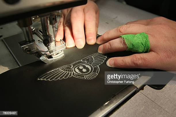 The Bentley Wings adorn the leather as a part of a seat is made at the Bentley Motors Factory on 19 November 2007 in Crewe England The Cheshire based...