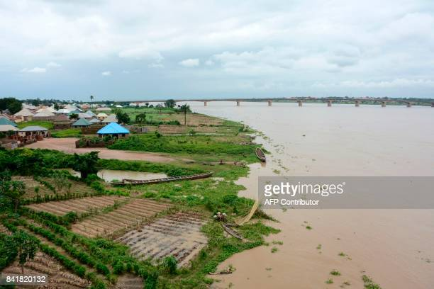 The Benue river overflows following heavy rains in Makurdi Benue State Nigeria on September 1 2017 At least one person has been killed after heavy...