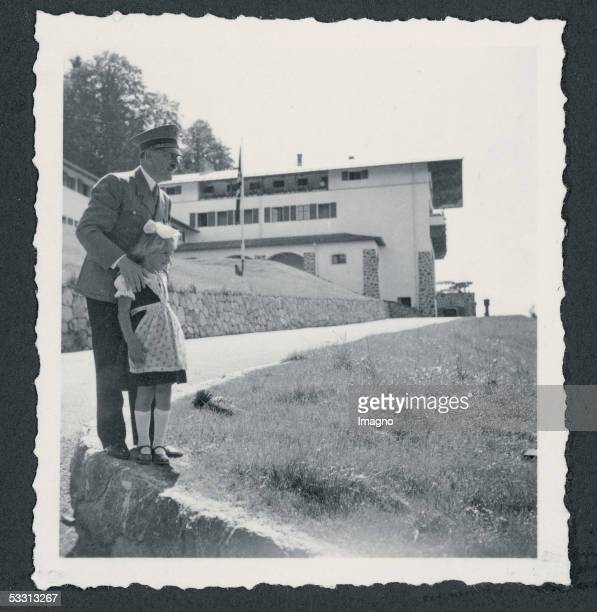 The Berghof of Adolf Hitler at the Obersalzberg near Berchtesgaden Adolf Hitler wearing a uniform with a little girl wearing a traditional costume in...