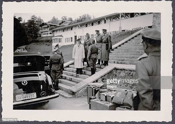 The Berghof of Adolf Hitler at the Obersalzberg near Berchtesgaden Adolf Hitler wearing a white coat and a uniform bonnet is standing on the stairs...