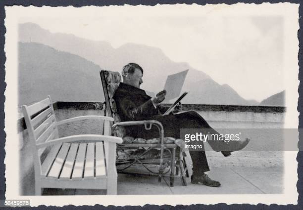The Berghof of Adolf Hitler at the Obersalzberg near Berchtesgaden Adolf Hitler at the patio of the Berghof wearing civil clothes sitting in a...