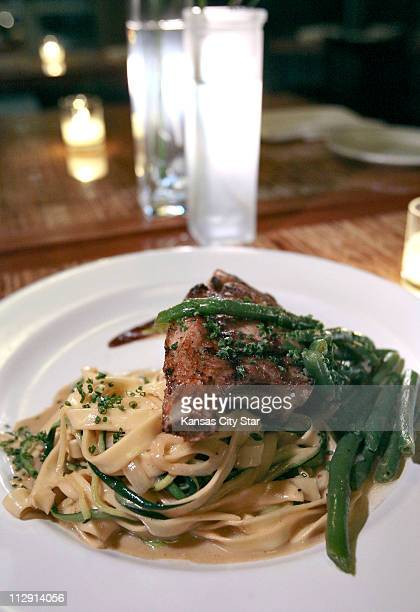 The Berkshire pork rib eye is served with caramelized shallots Maytag blue cheese and fig sauce atop house made pasta with green beans at Justus...