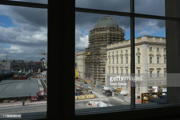 The Berlin City Palace is seen through a window of a nearby building on March 19 2019 in Berlin Germany The Berlin City Palace in German called the...