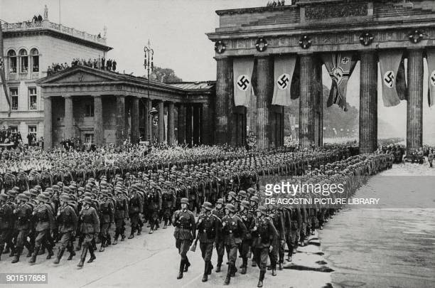The Berlin division parading in triumph through the Brandenburg Gate Berlin Germany World War II from L'Illustrazione Italiana Year LXVII No 30 July...