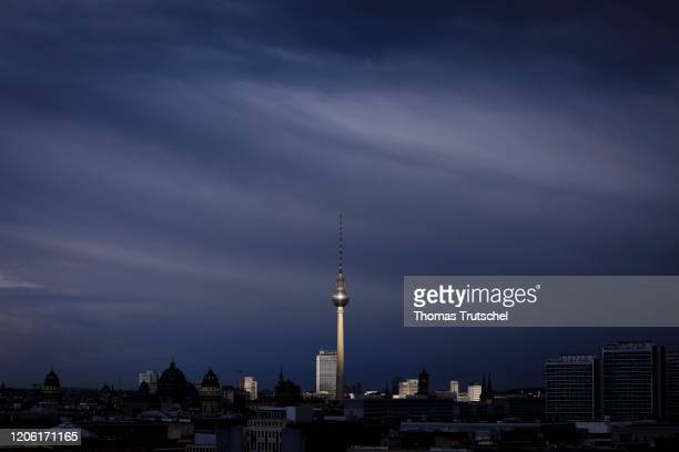 The Berlin television tower is illuminated by the sun during bad weather on March 09 2020 in Berlin Germany