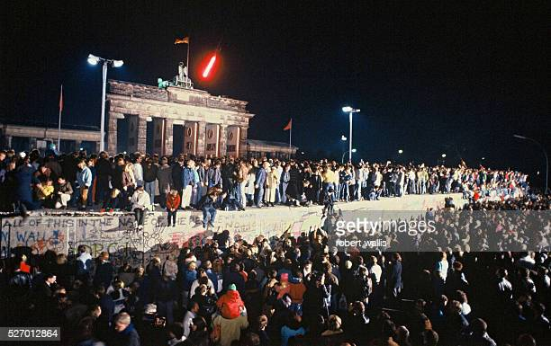 The Berlin Wall in front of Branderburg Gate on the night of November 9th 1989 Thousands of celebrants climbed on the Wall as news spread rapidly...