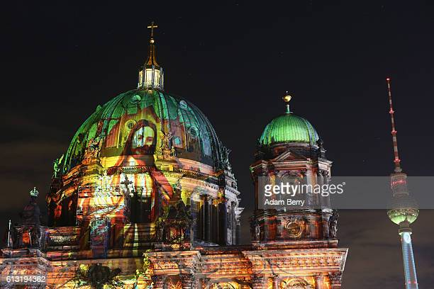 The Berliner Dom and Television Tower are illuminated with projections on October 7, 2016 in Berlin, Germany. Landmarks across the city are...