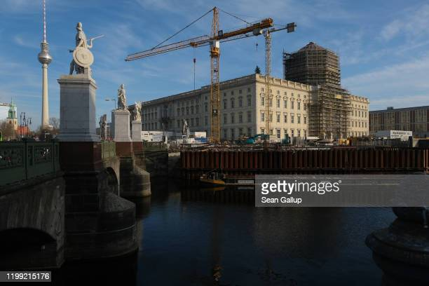The Berliner Schloss city palace, which will house the new Humboldt Forum, stands under construction as the broadcast tower at Alexanderplatz stands...