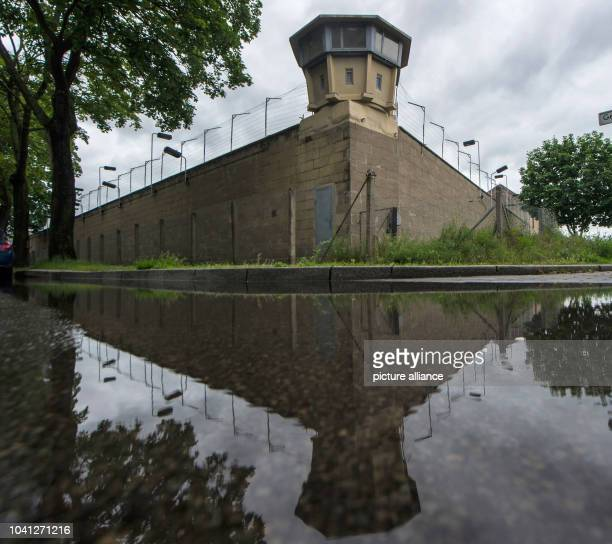 The Berlin-Hohenschoenhausen Memorial to the victims of the East German Ministry for State Security mirrors in a puddle in Berlin, Germany, 29 May...