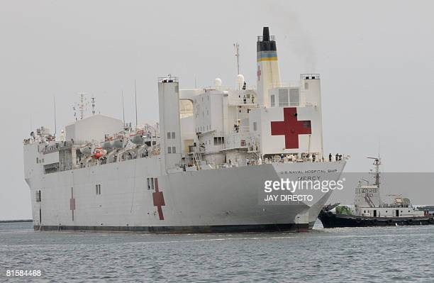 The berthing of USNS Mercy is seen at Manila's port on June 15 2008 The ship which is equipped with sophisticated medical equipment is on a tour of...
