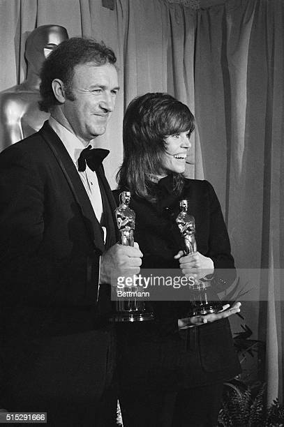 The best actor and actress for 1971 Gene Hackman and Jane Fonda hold on tightly to their just presented Oscars at the 44th annual Academy Awards at...