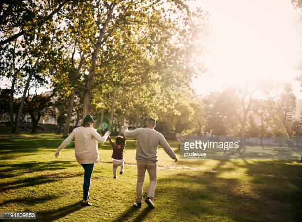 the best childhood is a fun-filled one - public park stock pictures, royalty-free photos & images