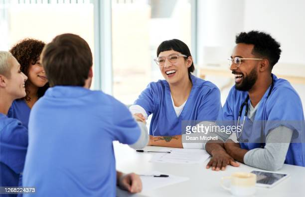 the best doctors to have on board - congratulating stock pictures, royalty-free photos & images