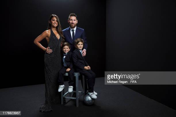 The Best FIFA Men's Player Award Lionel Messi of FC Barcelona and Argentina poses for a portrait with wife Antonella Roccuzzo and sons Mateo and Ciro...