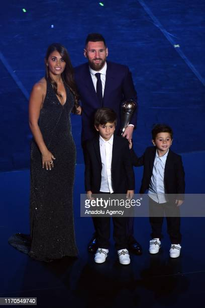 The Best FIFA Men's Player Award Winner Lionel Messi of FC Barcelona and Argentina poses with wife Antonella Roccuzzo and sons Mateo and Ciro during...