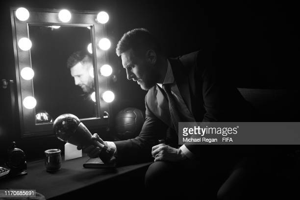 The Best FIFA Men's Player Award Winner Lionel Messi of FC Barcelona and Argentina pictured with the trophy backstage during The Best FIFA Football...