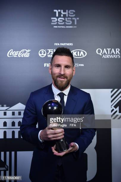 The Best FIFA Men's Player Award Winner Lionel Messi of FC Barcelona and Argentina poses with the trophy during The Best FIFA Football Awards 2019 at...