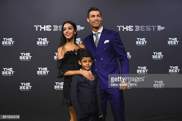 The Best FIFA Men's Player nominee Cristiano Ronaldo of Portugal and Real Madrid poses with Georgina Rodriguez and his son Ronaldo Junior as they...