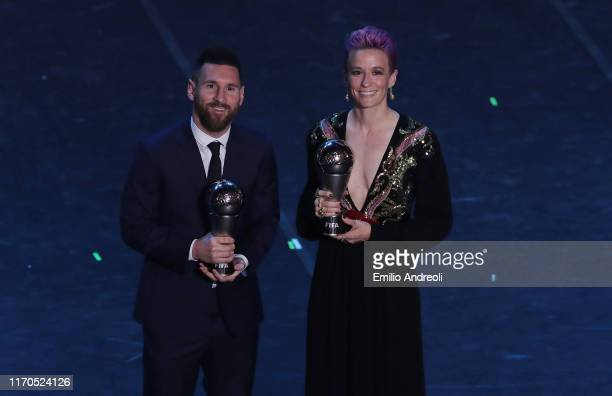 The Best FIFA Men's Player of the Year Lionel Messi and The Best FIFA Women's Player of the Year Megan Rapinoe pose for the photos at the end of The...